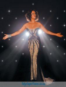 Belinda Davids as Whitney Houston